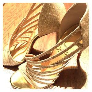 Christian Louboutin gold glitter stilettos